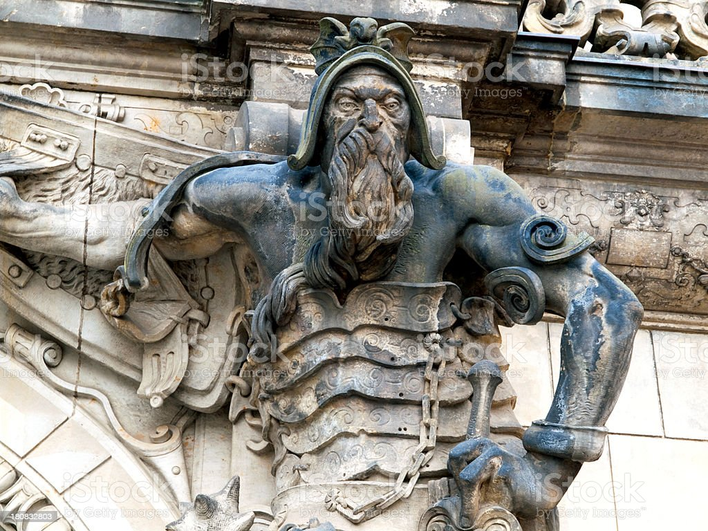 Ancient a warrior on entrance to The Old Masters Gallery. stock photo