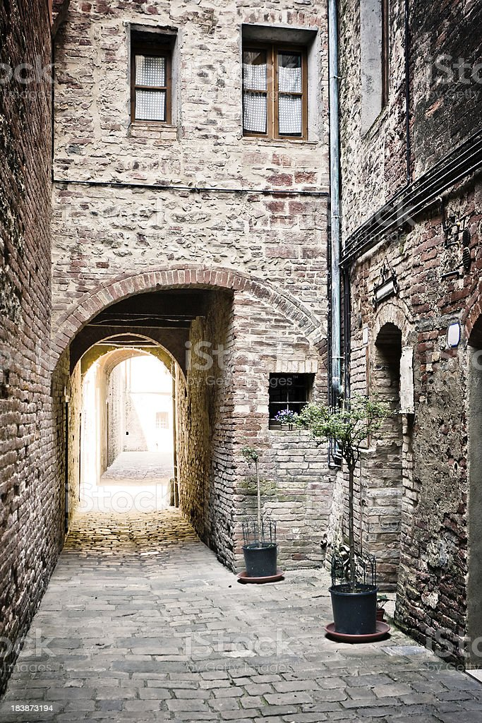 Ancient Alley with Arch in a Tuscan Village, Val d'Orcia stock photo