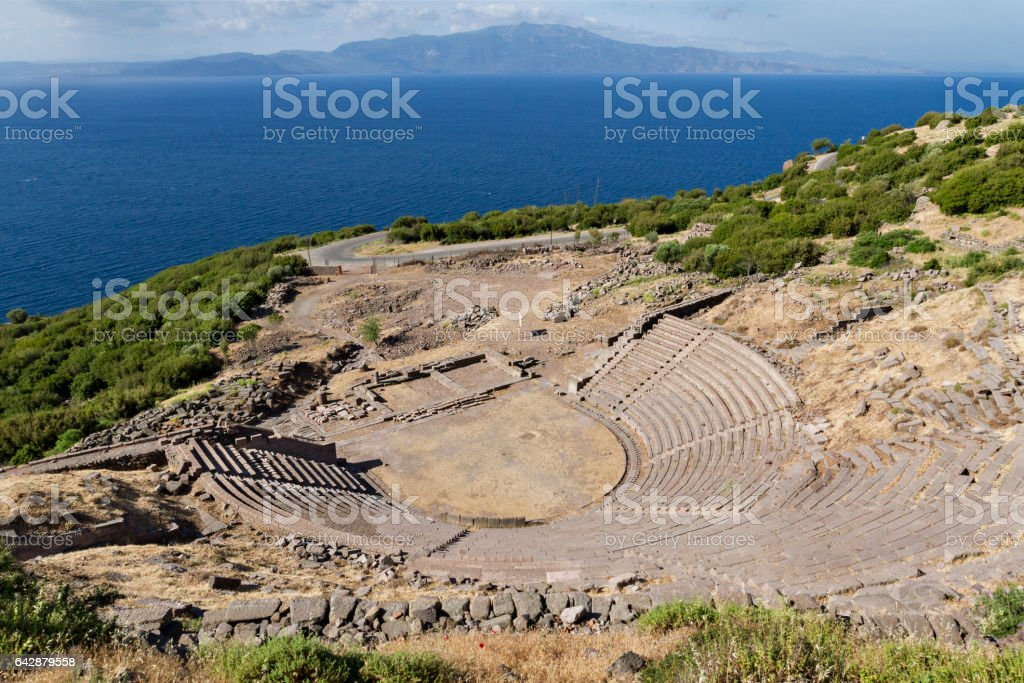 Ancient amphitheatre of Assos with the Greek Island Lesbos in the background. View from Turkey. stock photo