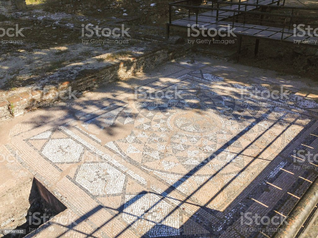 Ancient antique mosaic fragment stock photo