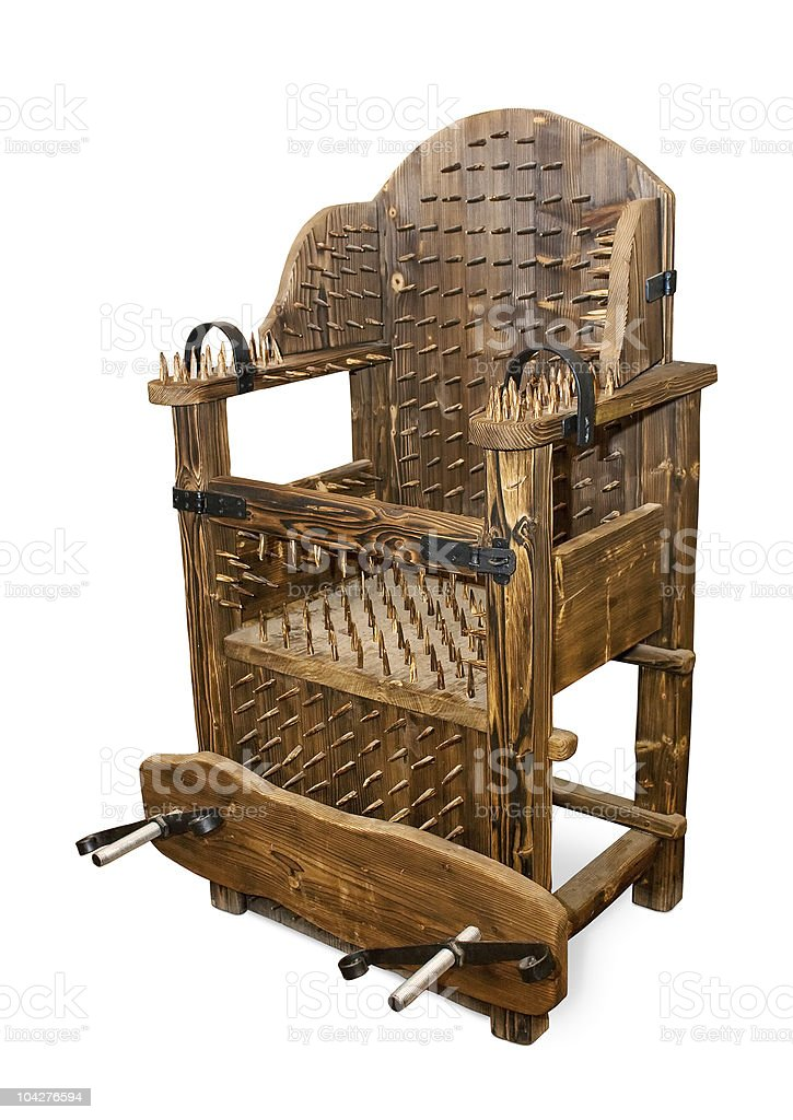 Ancient armchair for tortures stock photo