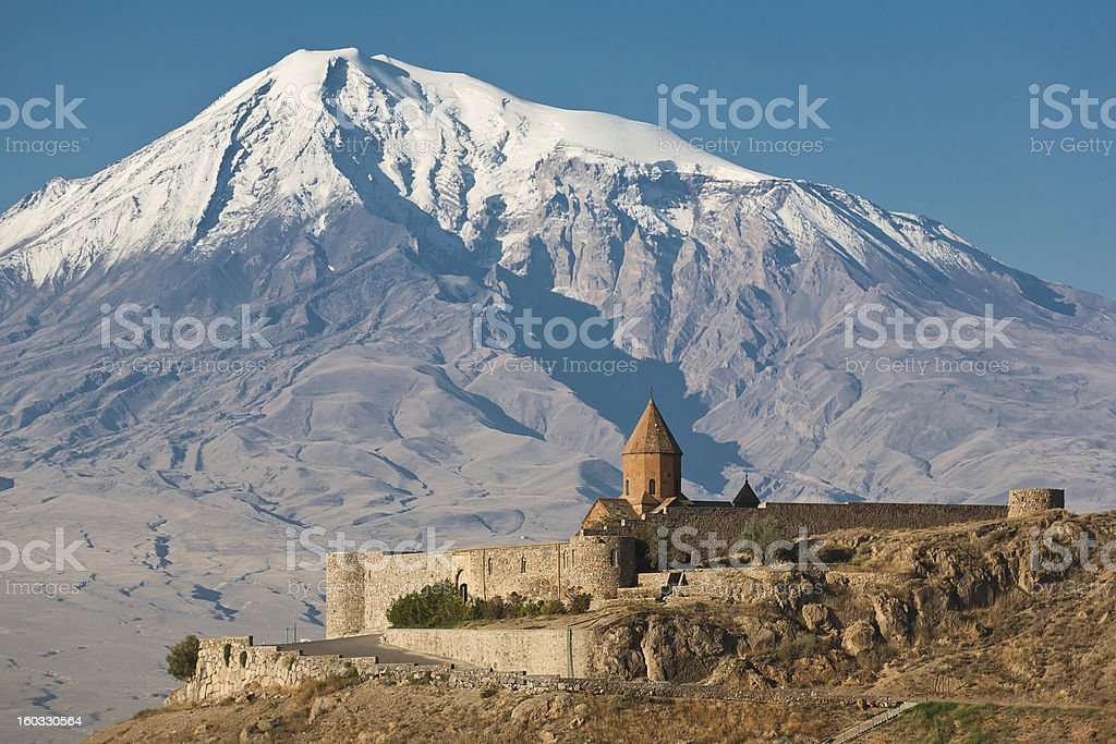 Ancient Armenian church with a mountain behind it stock photo