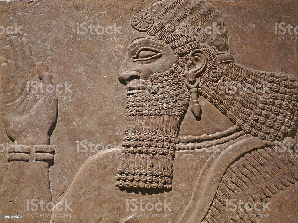 Ancient Assyrian wall carving stock photo
