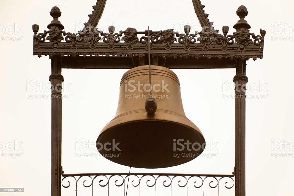 Ancient bell, cast iron decorative frame. stock photo