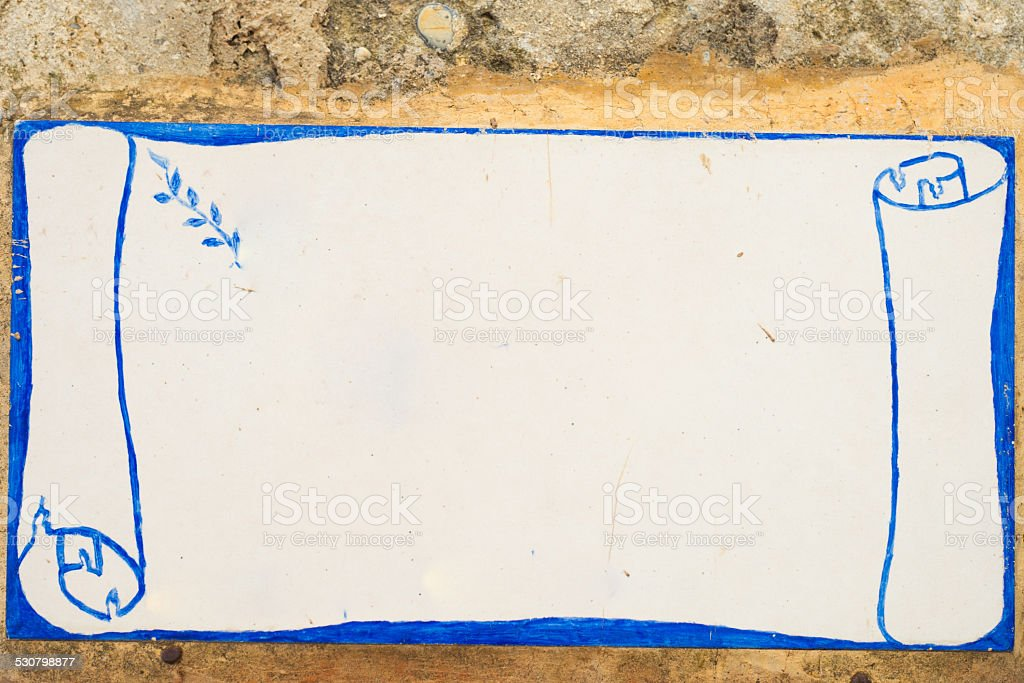 Ancient blank sign on old wall stock photo