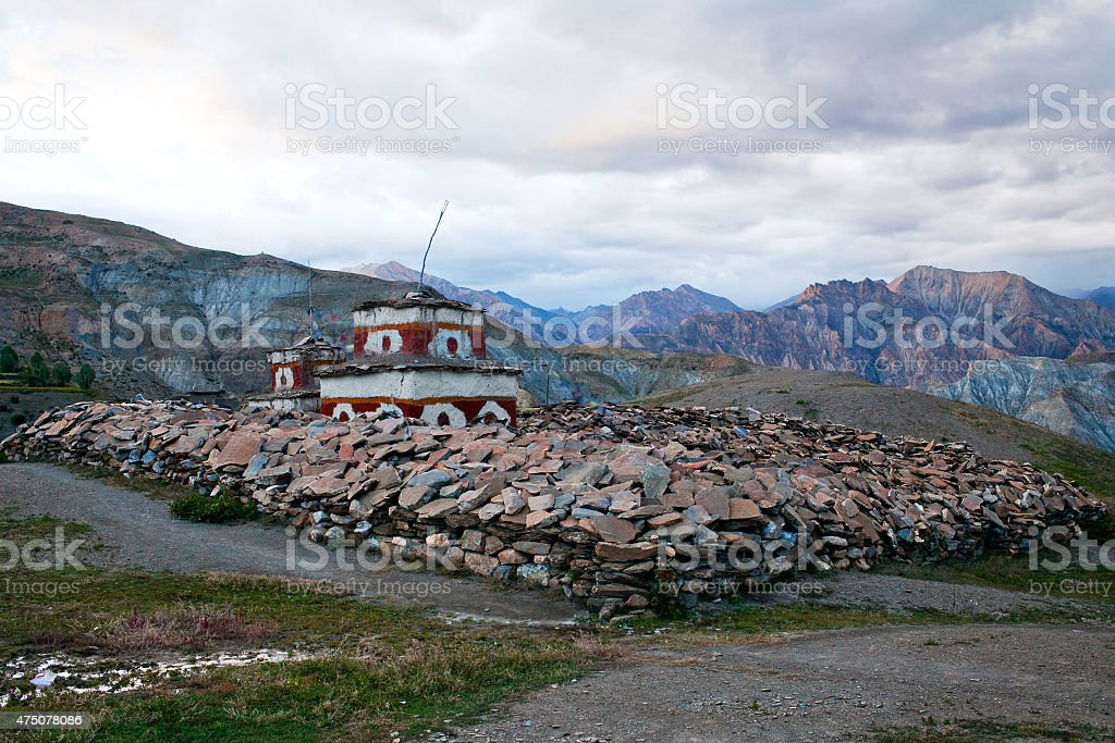 Ancient Bon stupa over mani stones in Saldang village, Nepal stock photo