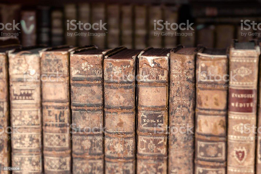 Ancient books on a shelf stock photo