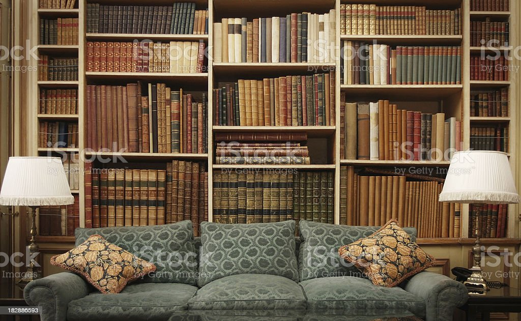 Ancient Books on an Old Bookshelf in a Library stock photo