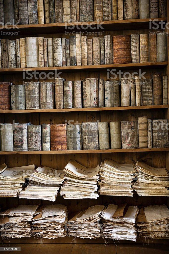 ancient books on bookshelf royalty-free stock photo