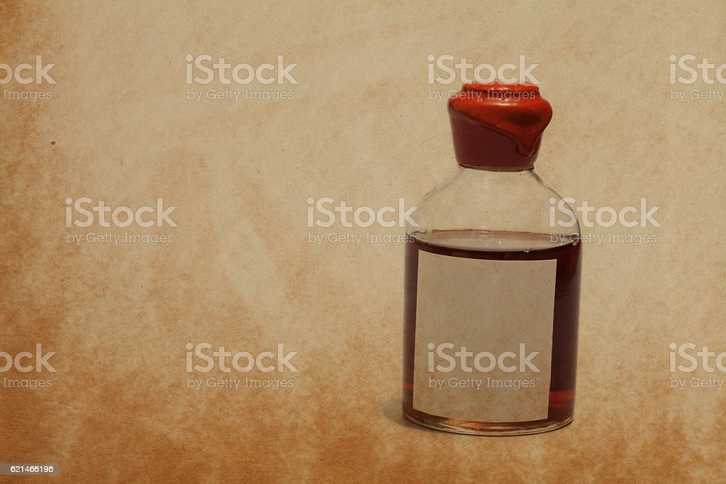 Ancient bottle with red wax cork, brown poison and blank stock photo