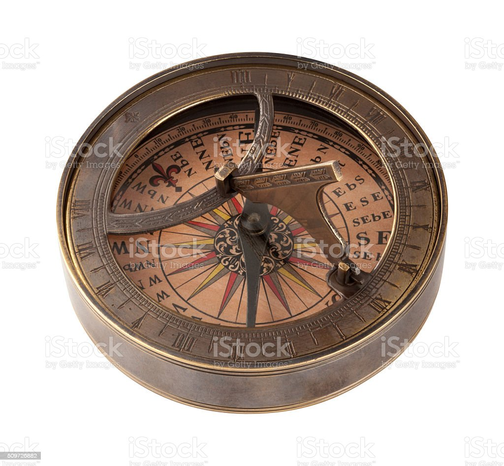 Ancient Brass Compass and Sundial stock photo