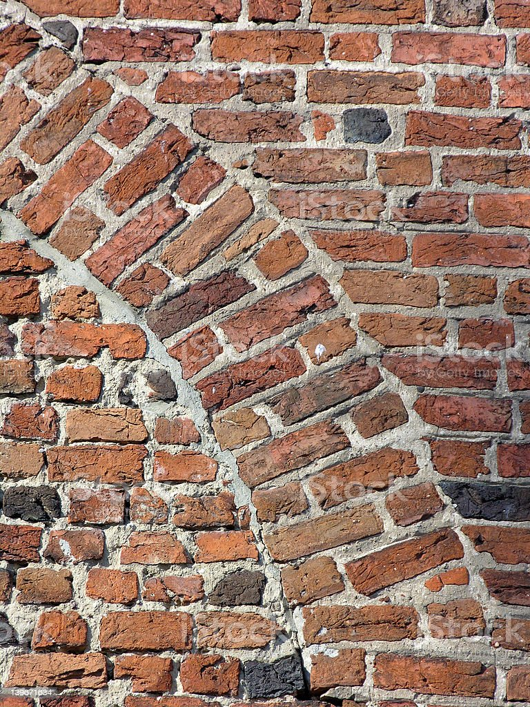 Ancient brick wall with arch royalty-free stock photo