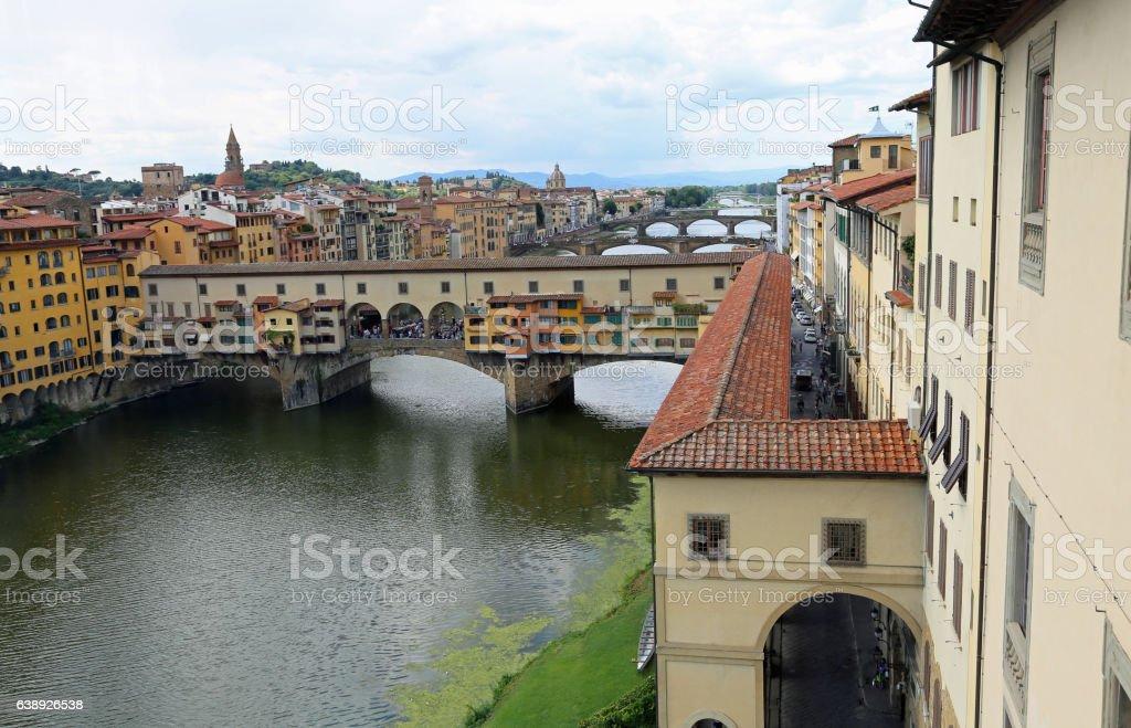 ancient bridge called Ponte Vecchio and Vasari Corridor in Flore stock photo
