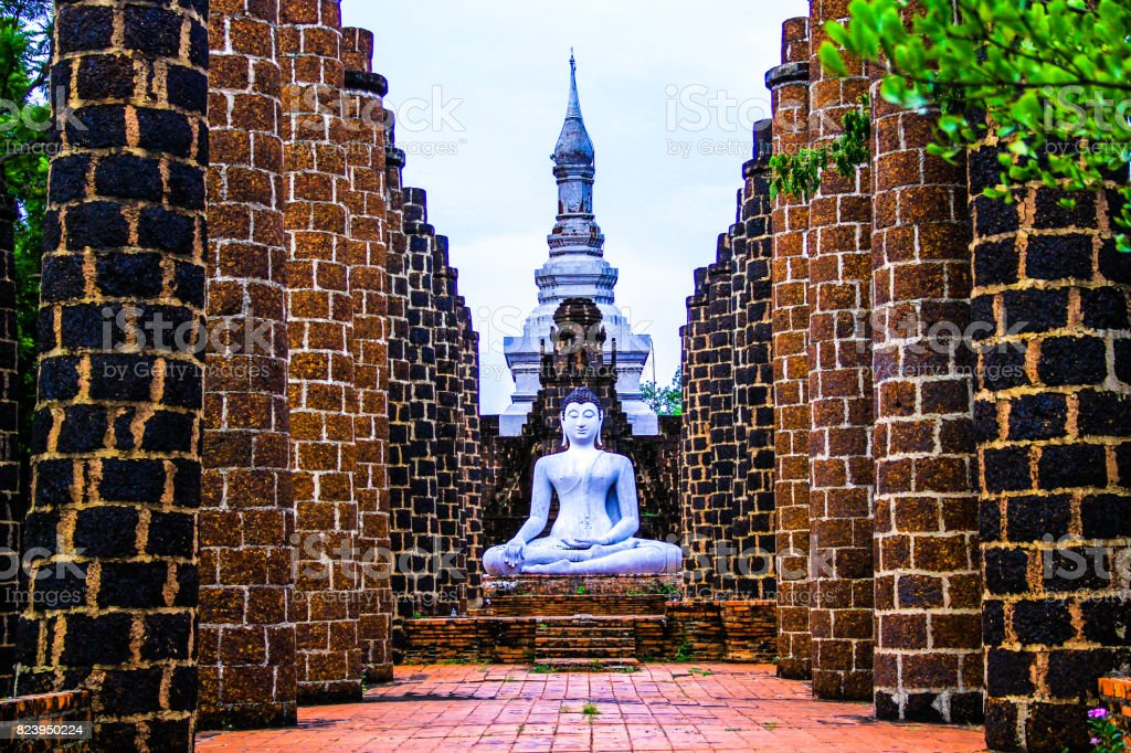 Ancient buddha statue and pagoda stock photo