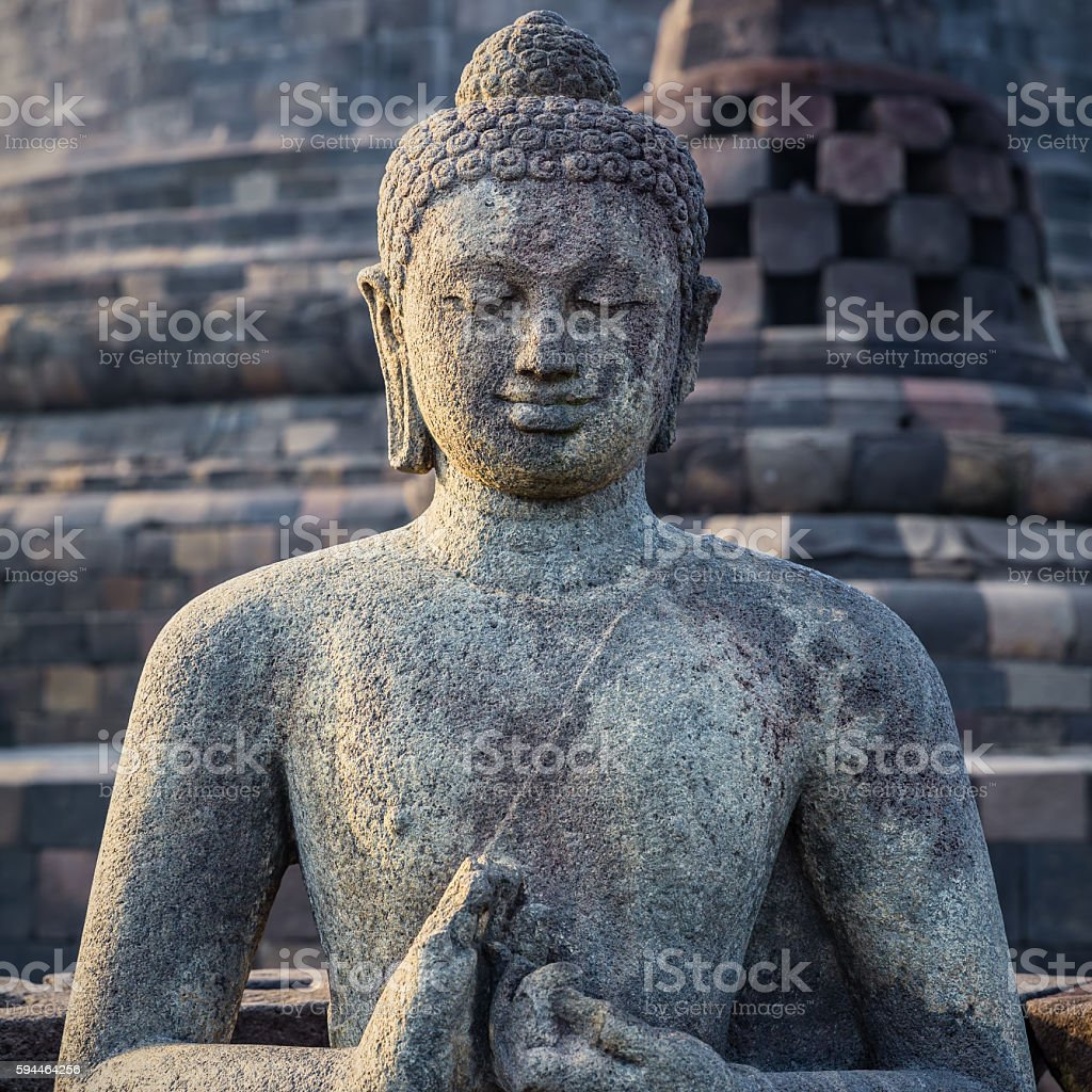 Ancient Buddha statue and stupa at Borobudur temple stock photo