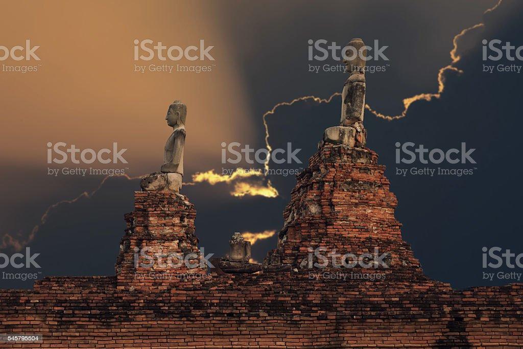 Ancient buddha statue at Wat Chaiwatthanaram Buddhist temple stock photo