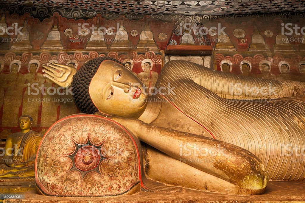 Ancient Buddha Statue in Dambulla Cave Temple, Sri Lanka stock photo