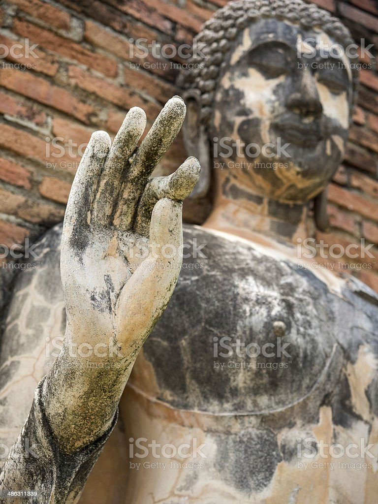Ancient Buddha Statue in Vitarka Mudra Posture, Sukhothai Province, Thailand stock photo