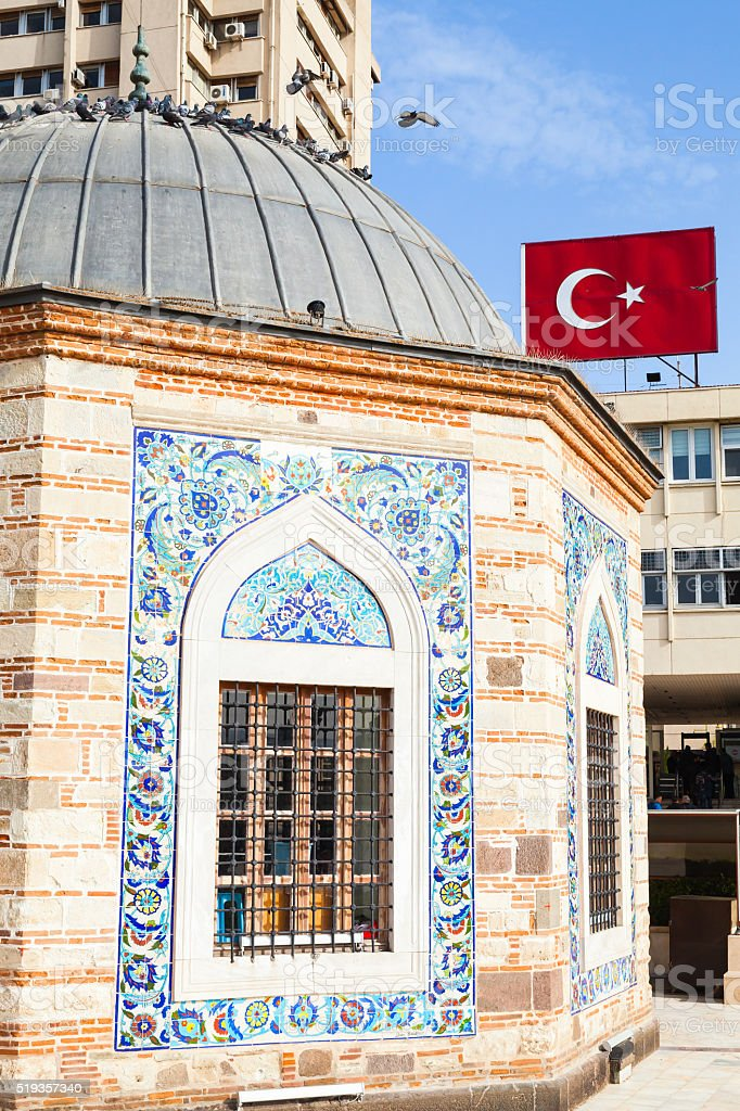 Ancient Camii mosque and Turkish flag stock photo