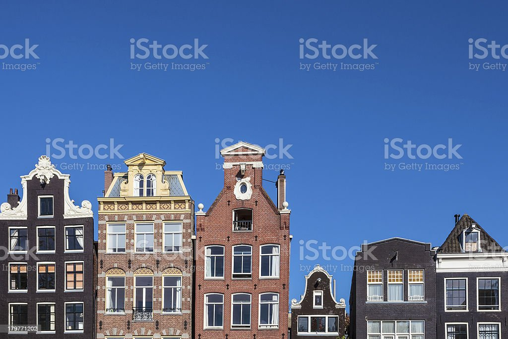 Ancient canal houses in the Dutch capital city Amsterdam stock photo