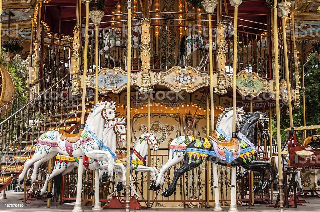 Ancient  carousel de Paris with horses stock photo