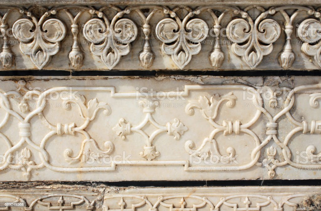 Ancient carved flower on marble in Taj Mahal, India stock photo