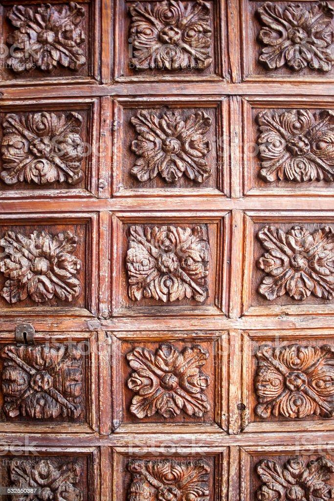 Ancient carved wooden door in La Orotava, Tenerife. stock photo
