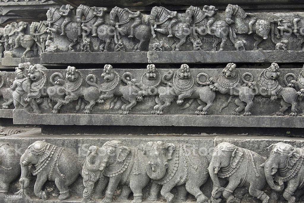ancient carvings of animals around the temple stock photo