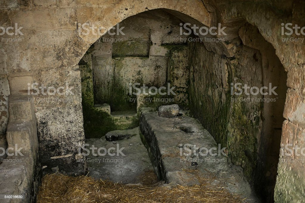 Ancient Cave Dwelling with bed in Matera stock photo