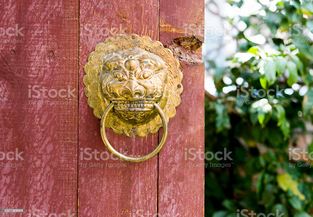 Ancient Chinese door with knockers stock photo