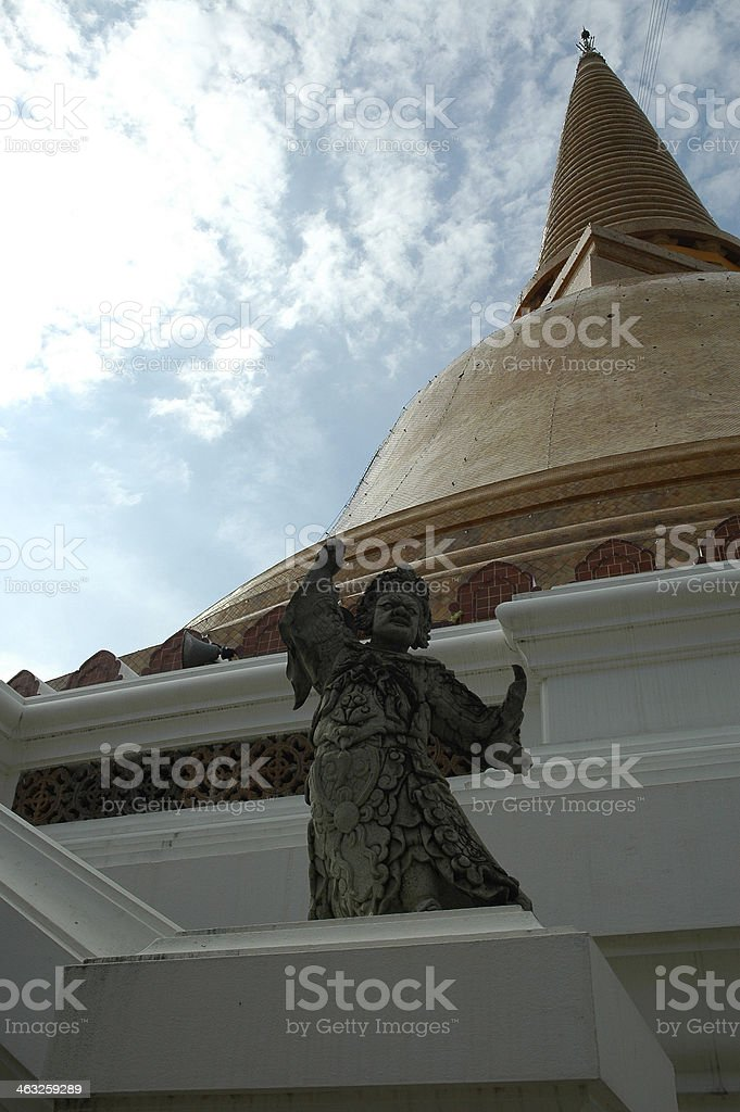 Ancient Chinese Stone Doll with Great Pagoda stock photo