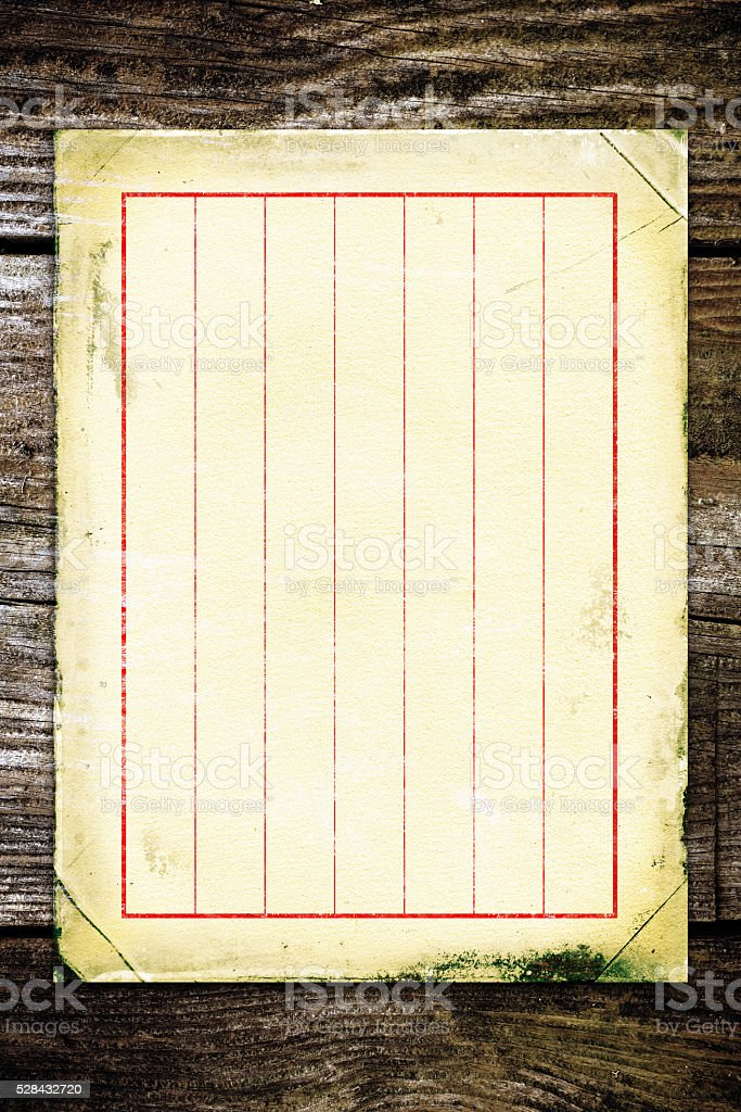 Ancient Chinese writing paper on wood background stock photo