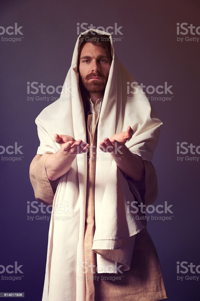 Ancient christian man holding his hand out stock photo
