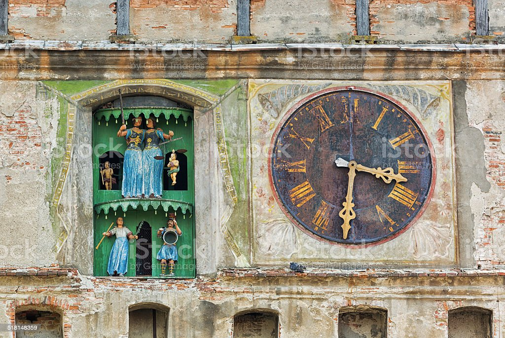 Ancient church clock with figurines. stock photo