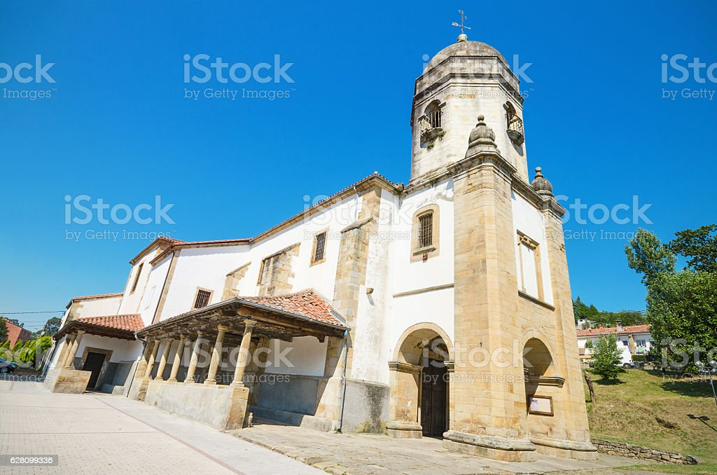 ancient church in the touristic village of Lastres, Asturias, Spain. stock photo