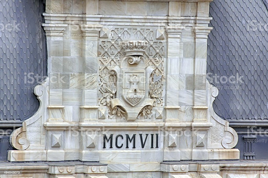 ancient coat of arms carved in stone stock photo