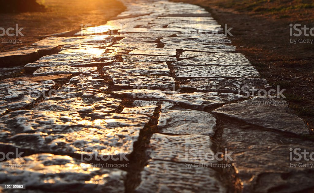 Ancient cobblestone paved path stock photo