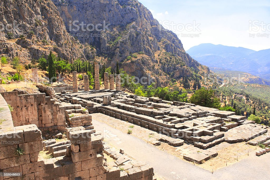 Ancient column and ruins Temple of Apollo in Delphi, Greece stock photo