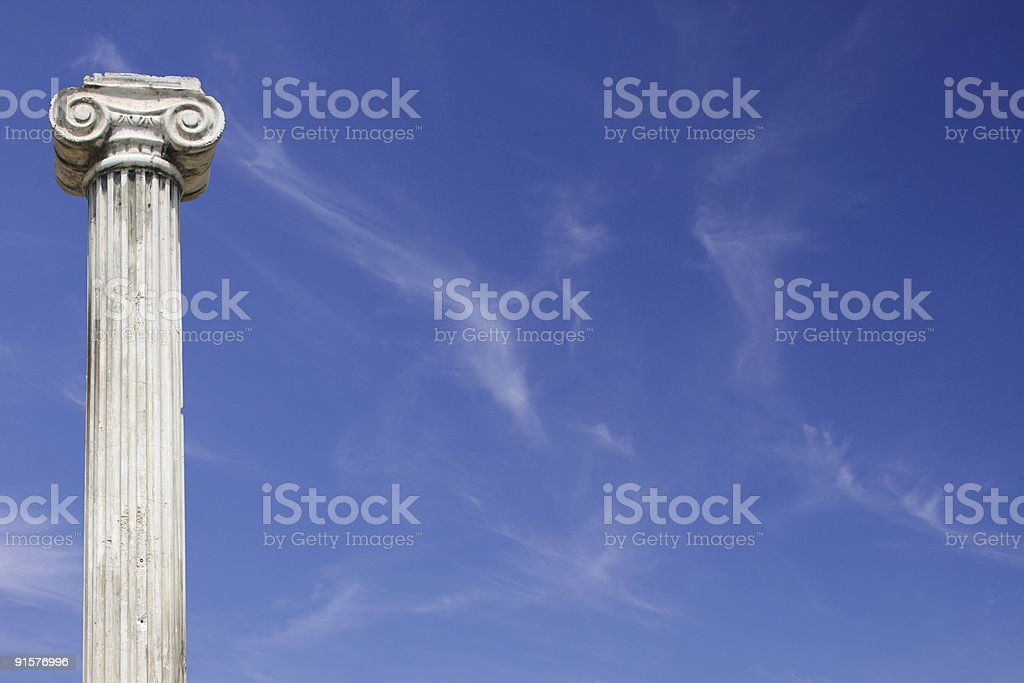 Ancient column and skies royalty-free stock photo
