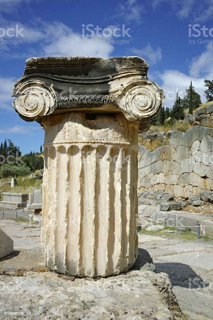 Ancient column in Ancient Greek archaeological site of Delphi, Greece stock photo