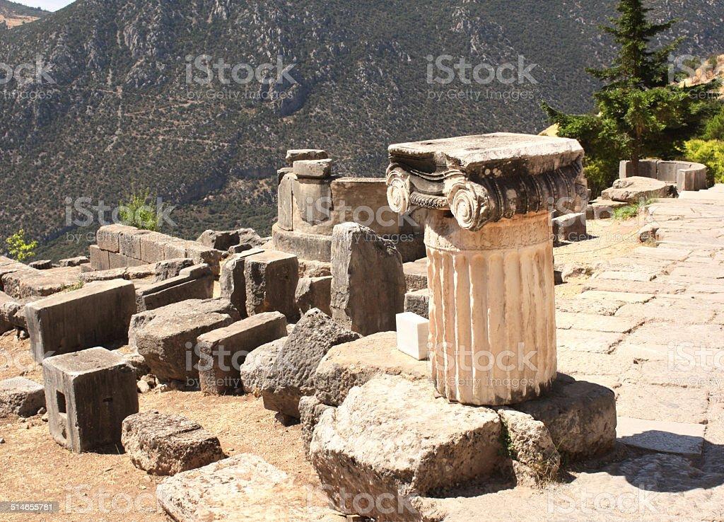 Ancient column in Delphi, Greece stock photo