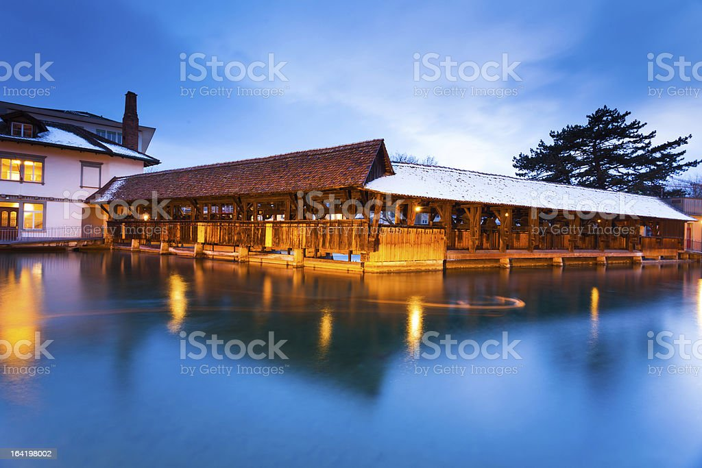 Ancient dam and wooden bridge in Thun, Switzerland royalty-free stock photo