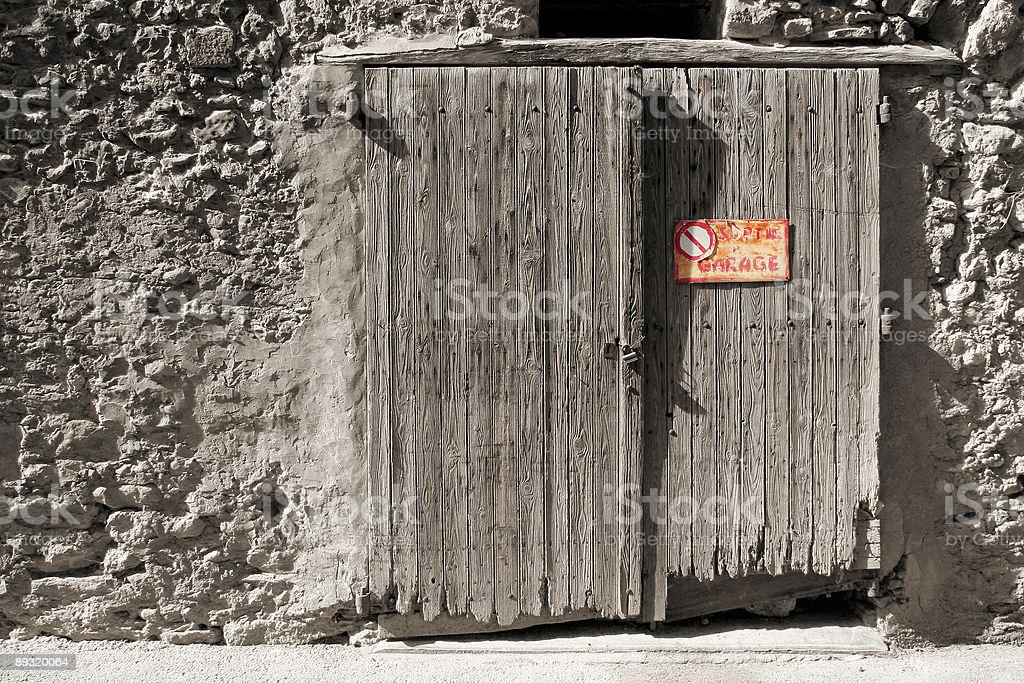 Ancient damaged garage door stock photo