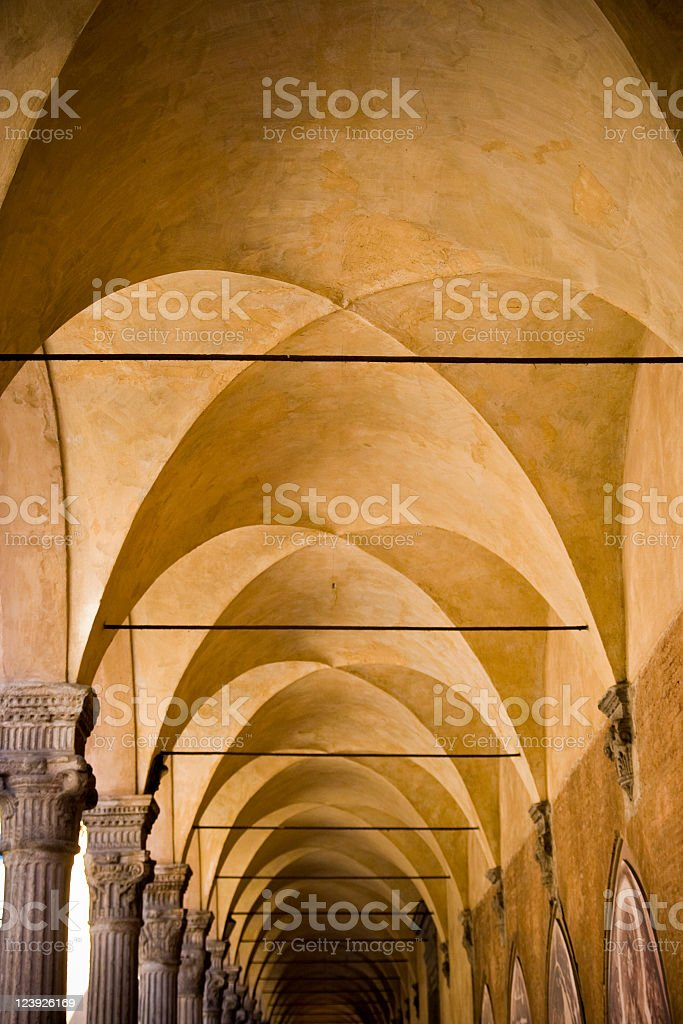 Ancient deep archway with exquisite engraved columns stock photo
