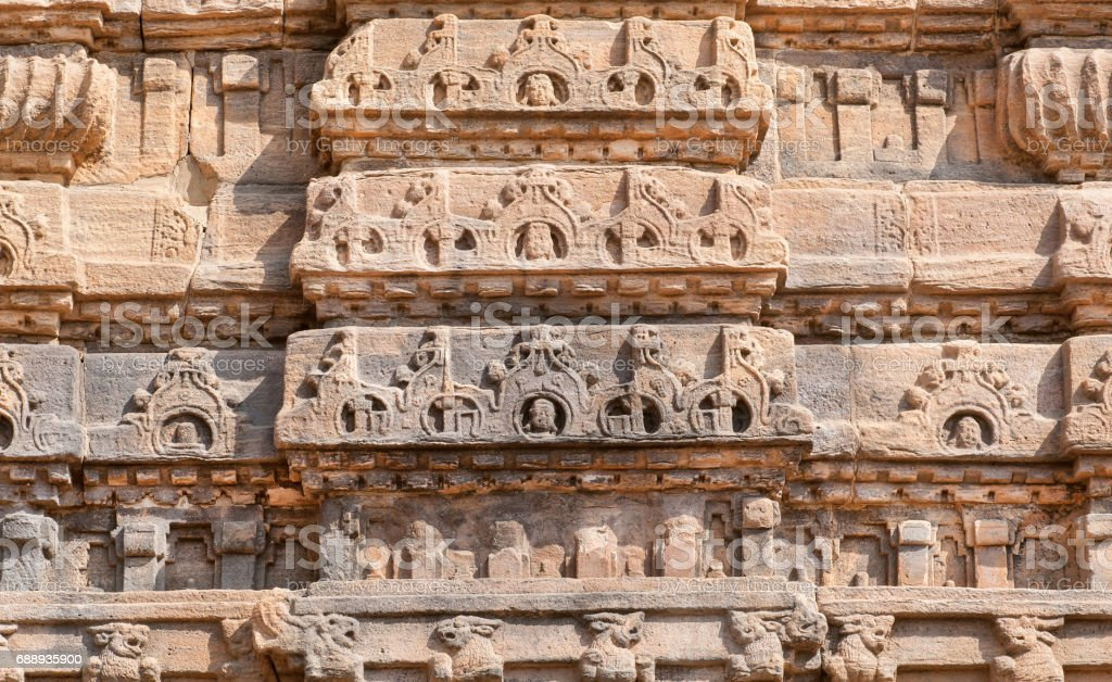 Ancient design of stone relief on wall of 7th century temple in Pattadakal of Karnataka, India. UNESCO World Heritage site with stone carved temples stock photo
