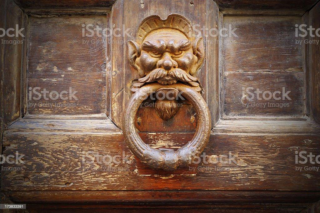 Ancient Devil Door Knocker royalty-free stock photo