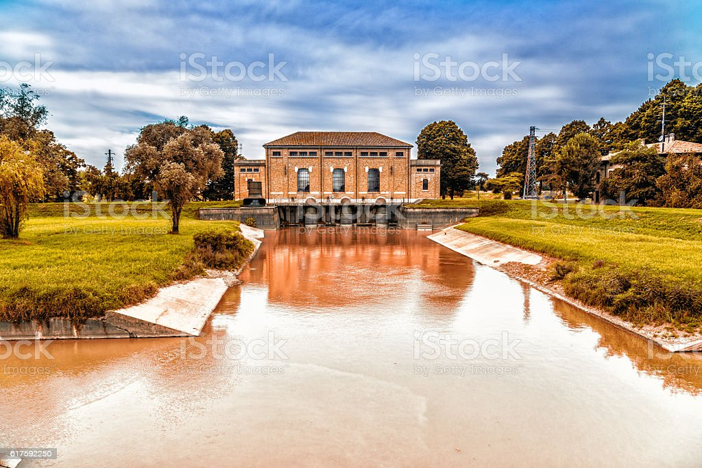 Ancient dewatering pump in sluice stock photo