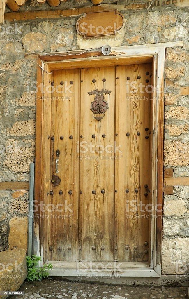 Ancient door in village. Symbolic handles on the doors. stock photo