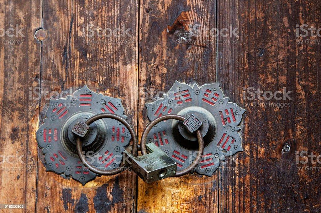 ancient door knocker of a Taoist temple stock photo