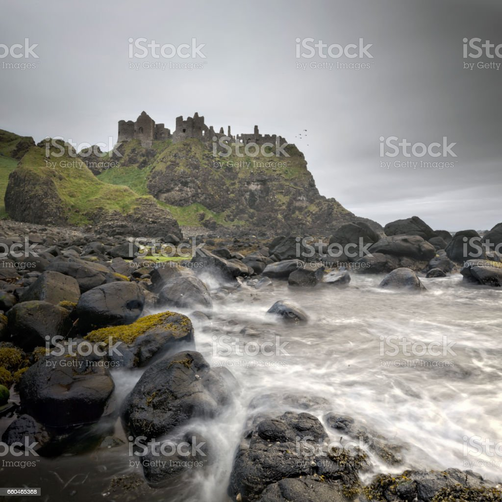 Ancient Dunluce Castle on a cliff, Ireland stock photo